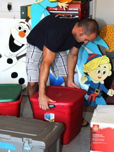 Ryan Erickson prepares his Christmas decorations for display. Jillian Danielson/RiverScene