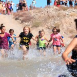 The first wave of the kids run at Havasu Mud Madness begins the first obstacle. Nathan Adler/RiverScene