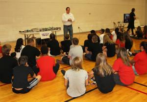Drake Finney of The Funny Papers, speaks 8th graders Thursday morning. Jillian Danielson/RiverScene