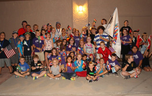 Starline Elementary students pose with USA riders Tuesday evening before the Parade of Nations.