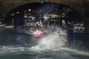 An IJSBA competitor performs in the night time freestyle demonstration under the London Bridge Saturday evening. Rick Powell/RiverScene