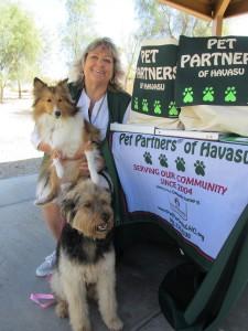 Barbara Schoof, president and program coordinator of Pet Partners of Havasu, poses with her two therapy dogs, Eva and Wally, at Jack Hardie Park Saturday in Lake Havasu City. Jayne Hanson/RiverScene