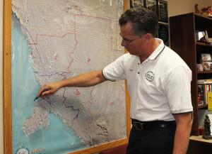 Lake Havasu Fire Department Chief Dennis Mueller draws on a map of Lake Havasu outlining flood plain areas. Jillian Danielson/RiverScene