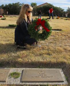 Stephanie Finch lays a wreath at the gravesite of a Veteran Monday morning. Jillian Danielson/RiverScene