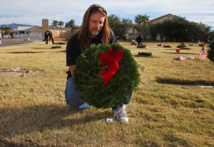 Dallas Finch lays a wreath at the gravesite of a Veteran Monday morning. Jillian Danielson/RiverScene