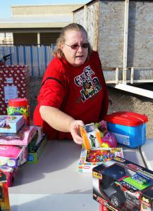 Glenda Norton sorts toys to be given to children throughout Desert Hills. Jillian Danielson/RiverScene