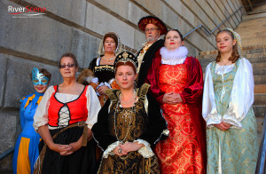Members of the Renaissance Faire cast pose for a photo in front of the London Bridge. Jillian Danielson/RiverScene