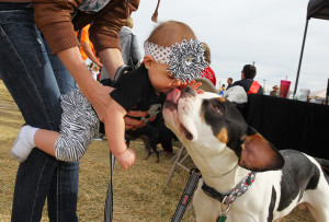 Khloe Ruger wins Best Kisser Saturday afternoon at Strut Your Mutt. Jillian Danielson/RiverScene