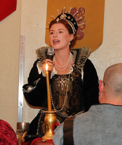 Melanie Preston, portraying Queen Elizabeth, speaks during the 2015 Royal Ball. Jillian Danielson/RiverScene