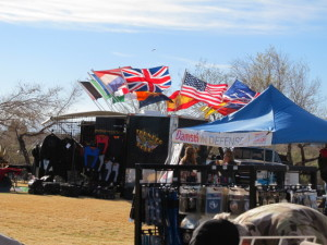 Flags flew stiff in the 20 mile-per-hour winds today at the Legends of Route 66 event. Judy Lacey/RiverScene