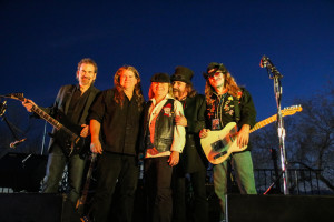 """An Eagles Tribute Band, """"Heartache Tonight"""" pose for a photo during the Legends of Route 66 Bike Build Off. Rick Powell/RiverScene"""