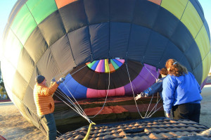 The balloon is filling up with gas while the team does its best to hold the envelope open. Courtesy Lyndsey Brueckner and Sadelle Finney