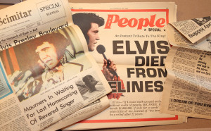 A collection of newspapers from Elvis's death are displayed in Evie's home. Jillian Danielson/RiverScene