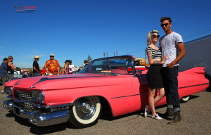Caron Scheeler and Andrew Gronefeld pose with a 1956 pink Caddy Saturday afternoon at Rockabilly Reunion. Jillian Danielson/RiverScene