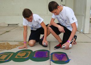 Layne Pringle and Michael Depuydt paint letters onto a caterpillar at Starline Elementary Friday morning. Jillian Danielson/RiverScene