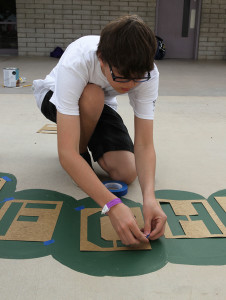 Jonathan Molien tapes letters to the ground Friday morning during Day of Service at Starline Elementary. Jillian Danielson/RiverScene