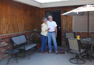 Early and Aldena pose with the house that they still reside in. Jillian Danielson/RiverScene