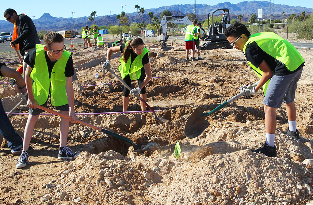 Students Team With City Workers For Green Project