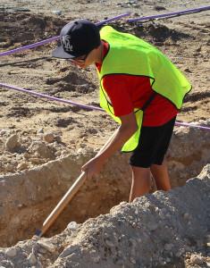 James Nelson digs a trench Thursday morning on the Island. Jillian Danielson/RiverScene