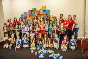Girl Scout and Brownie troops pose with the Lake Havasu Military Moms Wednesday evening. Rick Powell/RiverScene