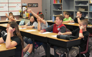 Amy Ulmer's reading class listens to Christy Crow of Goodwill speak to them about recycling. Jillian Danielson/RiverScene