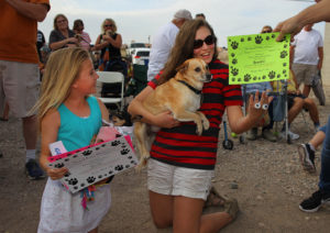 """The winners of the Chihuahua races are first place Emerald Noble holding """"Shiver"""" and second place Kadi Dokter holding """"Brando."""" Jillian Danielson/RvierScene"""