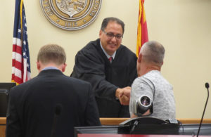 Judge Kalauli shakes the hand of every new veterans appearing before him. Judy Lacey/RiverScene