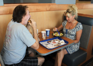 Randy and Susan Habeck eat their burger and salad Monday afternoon during the grand opening of Culvers. Jillian Danielson/RiverScene