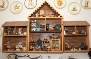 A wooden dollhouse hangs on a wall in the home of Angela and David. Jillian Danielson/RiverScene
