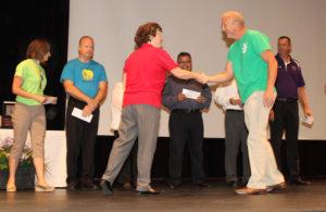 K-12 Foundation member Monica Hall presents checks to Lake Havasu principals. Jillian Danielson/RiverScene