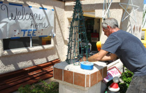 David Jones sets up a Christmas decoration to welcome Tee home Thursday from the hospital. Jillian Danielson/RiverScene