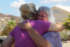 Beth receives a hug from a friend in the car club Thursday afternoon. Jillian Danielson/RiverScene