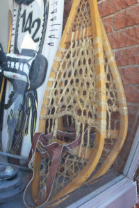 Snow shoes sit on display in the window of Best Bet Pawn. Jillian Danielson/RiverScene