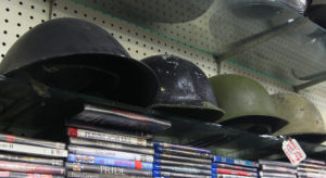 Military helmets sit on display at Best Bet Pawn Shop. Jillian Danielson/RiverScene
