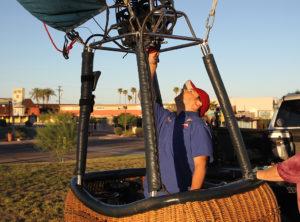 Jim Dolan preps the burner for flight Thursday morning. Jillian Danielson/RiverScene