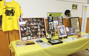 Photos and memorabilia sit on a table at the McCulloch Chainsaw reunion. Jillian Danielson/RiverScene