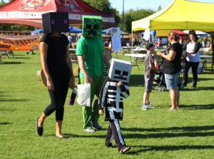 "Fall Fun Fair goers dressed as ""Mine Craft"" characters Saturday afternoon. Jillian Danielson/RiverScene"