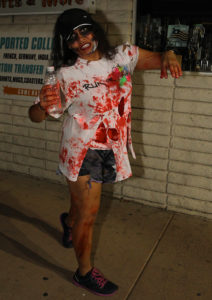 Elizabeth Fox participates in the Zombie Pub Crawl Saturday evening. Jillian Danielson/RiverScene