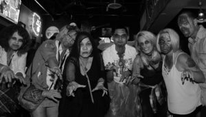 "A group of ""Zombies"" pose for a photo at the Flying X Saturday evening. Jillian Danielson/RiverScene"
