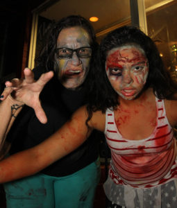 Ginger Willis and Savannah Baxter participate in the Zombie Pub Crawl Saturday evening. Jillian Danielson/RiverScene
