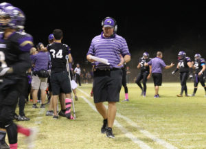 Coach Karl Thompson works on the sidelines of a LHHS Varsity football game Friday evening. Jillian Danielson/RiverScene