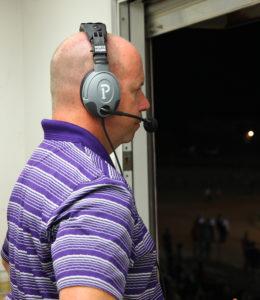 Lt. Joe Harrold watches the varsity game from the press box Friday evening. Jillian Danielson/RiverScene