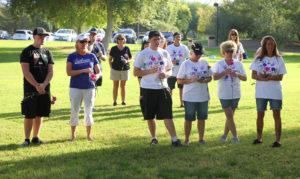 Walkers listen to LHCPD Captain Troy Sterling speak Sunday morning at Rotary Park. Jillian Danielson/RiverScene
