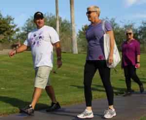 LHCPD Chief Dan Doyle and Eileen Nexsen walk in the Domestic Violence Awareness Walk Sunday morning. Jillian Danielson/RiverScene