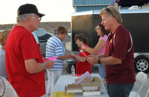 Steve Greeley, Traceye Jones, and Monica Hall hand out wristbands Tuesday evening at Taste of Havasu. Jillian Danielson/RiverScene
