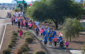 Participants walk along Highway 95 Saturday morning during the Breast Cancer Awareness Walk. Rick Powell/RiverScene