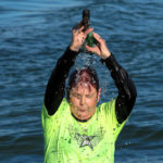 Nedra starting the day with a Cowbell Shower!! Ken Gallagher/RiverScene