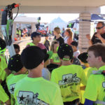 Robert Sand, giving the kids a little instruction on race prep and tech inspection. Ken Gallagher/RiverScene
