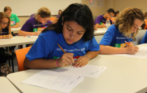 Viviana Solis works on math problems Friday morning at ASU. Jillian Danielson/RiverScene