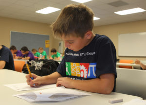 Kian Stone works on math problems Friday morning at ASU. Jillian Danielson/RiverScene